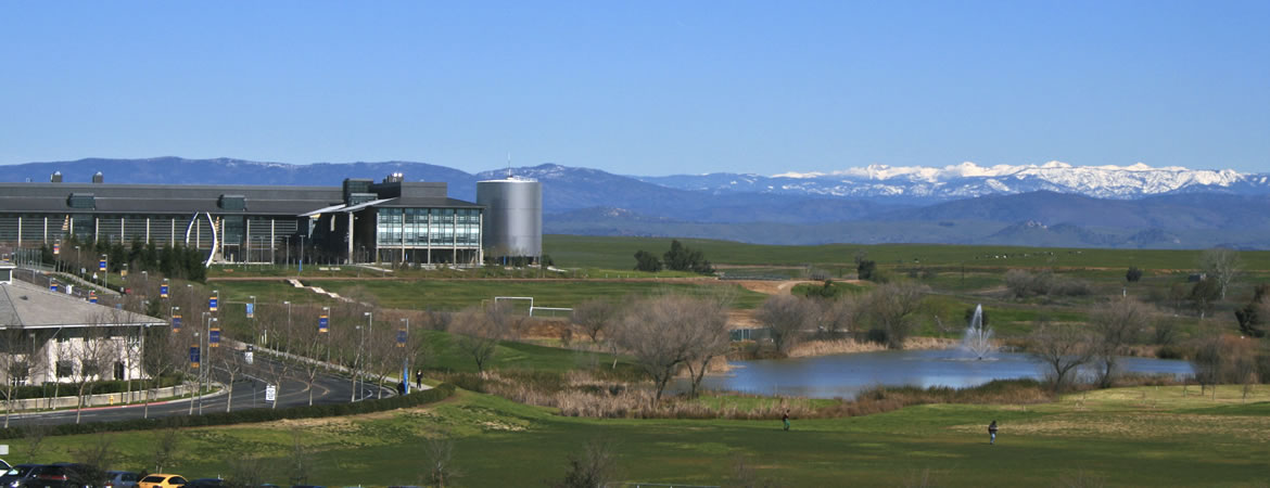 View of campus from distant with snow capped Sierra's in the distance
